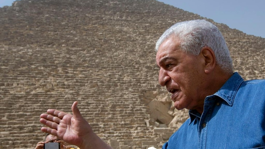 Egyptian archaeologist Zahi Hawass, Egypt's former head of antiquities, speaks in front of the Great pyramid, built by Cheops, known locally as Khufu in Giza, Egypt, Thursday, June 2, 2016. A scientific team scanning the Great Pyramid aimed at discovering the famed pharaonic monument's secrets including possible hidden burial chambers. (AP Photo/Amr Nabil)