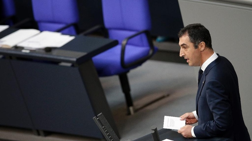 Cem Ozdemir member of the Green party with Turkish roots, speaks during a meeting of the German Federal Parliament, Bundestag, at the Reichstag building in Berlin, Germany, Thursday, June 2, 2016. The German Parliament is to vote Thursday on whether to label the killings of Armenians by Ottoman Turks a century ago as genocide. In the background are the empty seats of German Chancellor Angela Merkel, right, and Vice -Chancellor Sigmar Gabriel, left. (AP Photo/Michael Sohn)