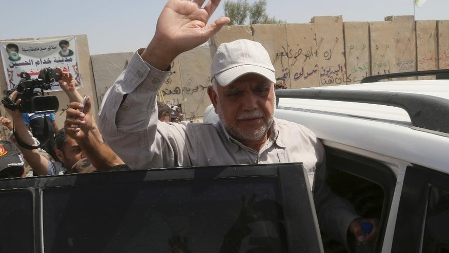 Hadi al-Amiri, commander of the Popular Mobilization Forces, visits forces in Saqlawiyah near Fallujah, Iraq, Thursday, June 2, 2016. (AP Photo/Khalid Mohammed)