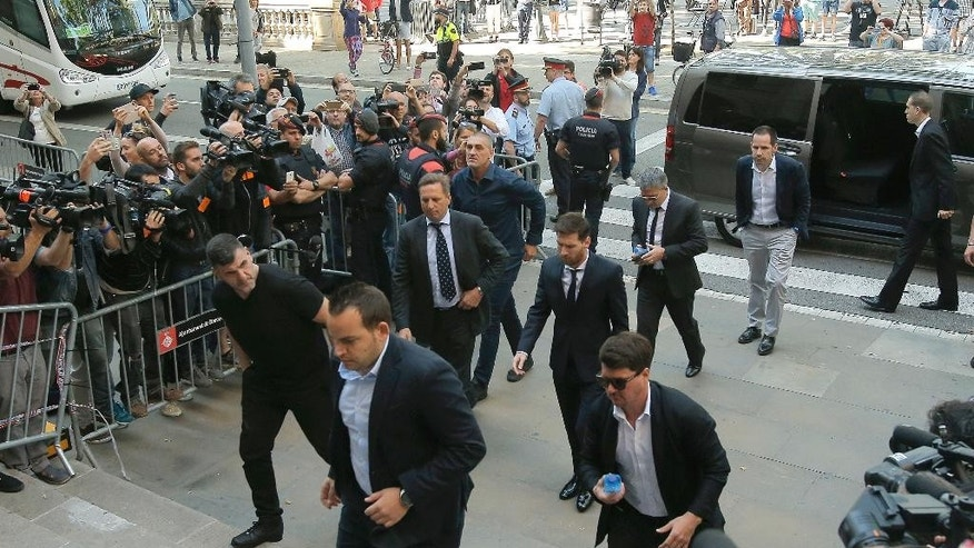 Barcelona soccer player Lionel Messi, center back, arrives at a court in Barcelona, Spain, Thursday, June 2, 2016. Messi's tax trial began Tuesday. Messi and his father, Jorge Horacio, have been charged with three counts of tax fraud. They could be sentenced to nearly two years in prison if found guilty of defrauding Spain's tax authority of 4.1 million euros ($4.5 million) from 2007-09. (AP Photo/Manu Fernandez)