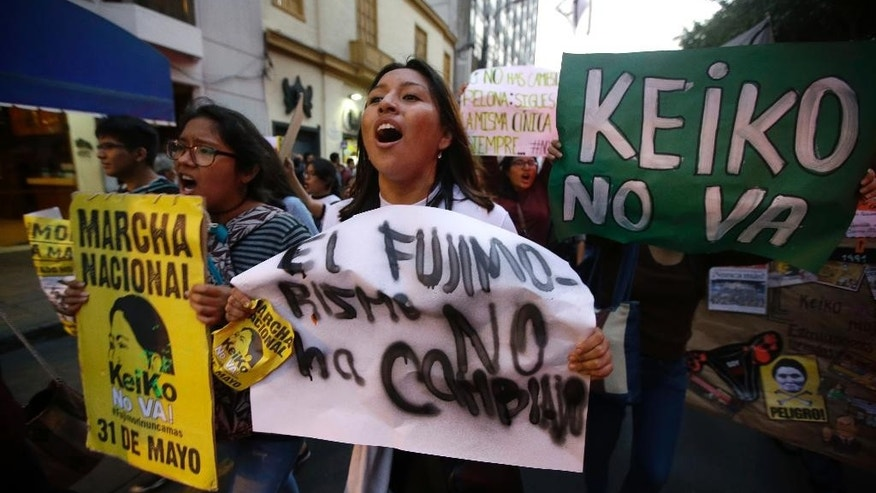 Demonstrators protest against presidential candidate Keiko Fujimori, the daughter of disgraced former leader Alberto Fujimori, at Plaza San Martin in downtown Lima, Peru, Tuesday, May 31, 2016. The South American country is gearing up for a tight June 5th runoff between Keiko Fujimori, the daughter of jailed former President Alberto Fujimori, and former World Bank economist Pedro Pablo Kuczynski.  (AP Photo/Martin Mejia)