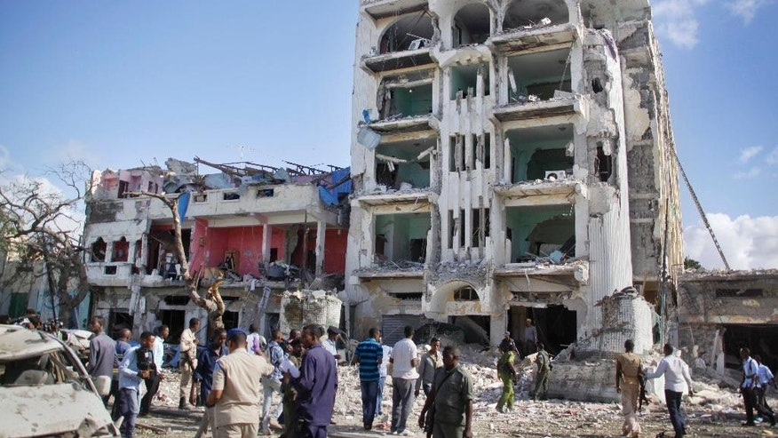 June 2, 2016: Security forces examine the scene after a bomb attack on Ambassador Hotel in Mogadishu, Somalia.