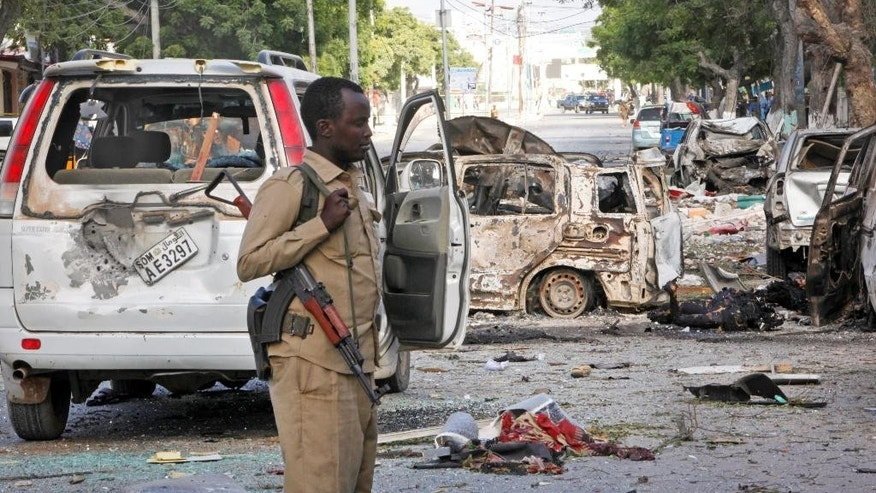 June 2, 2016: A Somali policeman patrols at the scene after a bomb attack on Ambassador Hotel in Mogadishu, Somalia.