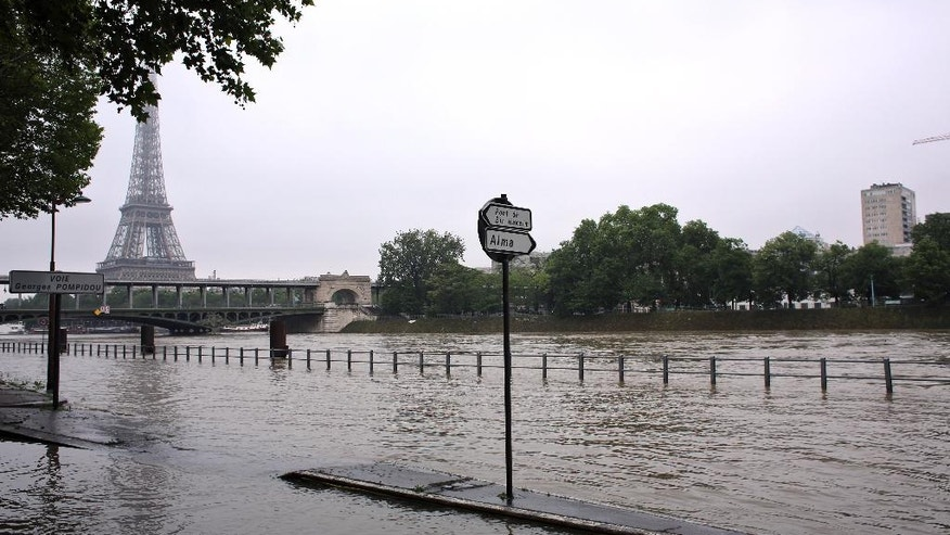 Overflowing embankments are seen near the Eiffel Tower, in Paris, Wednesday, June 1, 2016. Paris City Hall closed roads along the shore of the Seine from the southwest edge of the city to the neighborhood around the Eiffel Tower as the water level has risen 4.3 meters (14 feet 1 inches) higher than usual. (AP Photo/Thibault Camus)