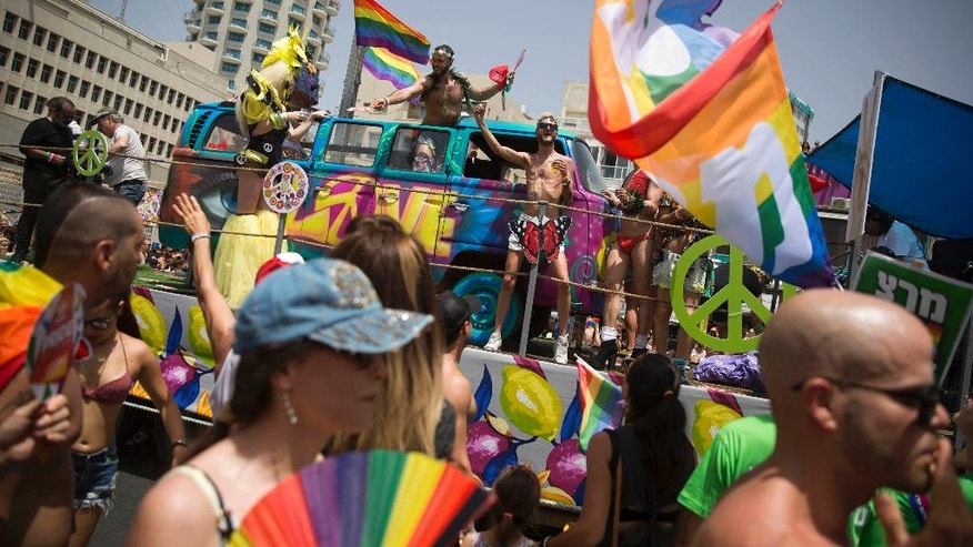People participate the annual Gay Pride Parade in Tel Aviv, Israel, Friday, June 3, 2016. About 200,000 people from the LGBT community in Israel and abroad attended in Tel Aviv's annual gay pride parade Friday, the largest event of its kind in the Middle East. (AP Photo/Oded Balilty)