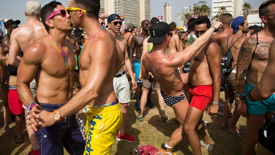 People dance during the annual Gay Pride Parade in Tel Aviv, Israel, Friday, June 3, 2016. About 200,000 people from the LGBT community in Israel and abroad attended in Tel Aviv's annual gay pride parade Friday, the largest event of its kind in the Middle East. (AP Photo/Oded Balilty)