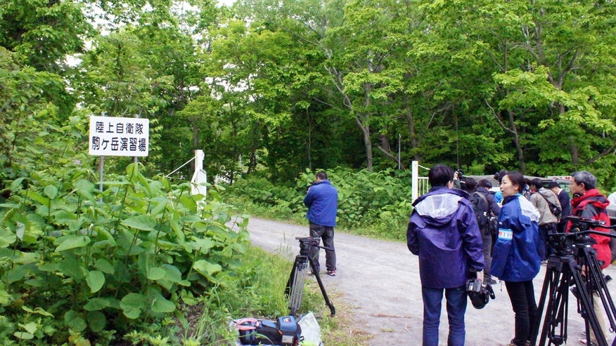 June 3, 2016: Media members gather near a military drill area in Shikabe town, on the northernmost main island of Hokkaido