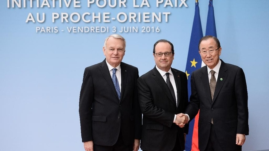French Foreign minister Jean-Marc Ayrault, left, French President Francois Hollande and United Nations Secretary General Ban Ki-moon, right, pose for photographers prior to an international meeting in a bid to revive the Israeli-Palestinian peace process in Paris, France, Friday, June 2, 2016. U.S., European and Arab diplomats meet in Paris for a French-led effort to revive the Mideast peace process, despite skepticism from Israel. (Stephane de Sakutin/Pool Photo via AP)