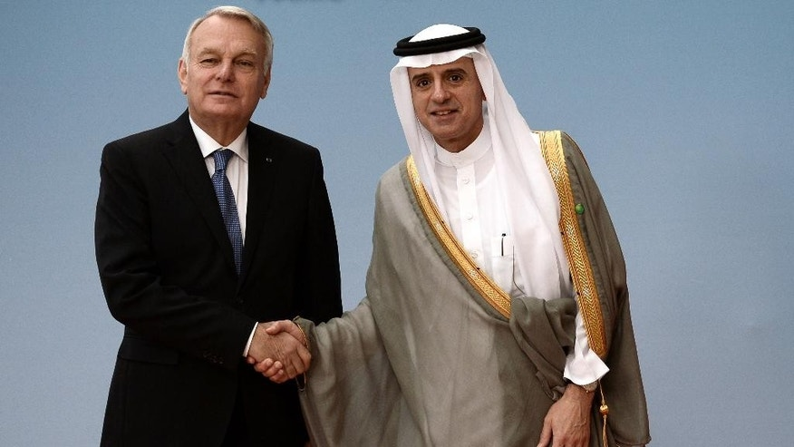 French Foreign minister Jean-Marc Ayrault, left, shakes hands with Saudi Foreign Minister Adel al-Jubeir prior to an of an international meeting in a bid to revive the Israeli-Palestinian peace process in Paris, France, Friday, June 2, 2016. U.S., European and Arab diplomats meet in Paris for a French-led effort to revive the Mideast peace process, despite skepticism from Israel. (Stephane de Sakutin/Pool Photo via AP)