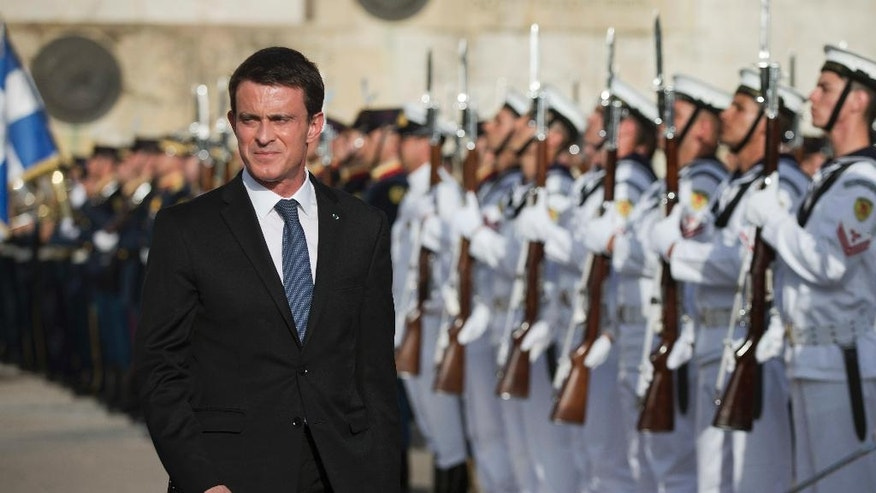 French Prime Minister Manuel Valls reviews the Honor guard during a wreath laying ceremony at the tomb of the Unknown Soldier in central Athens on Thursday, June 2, 2016. Valls has arrived in Greece for a two-day visit expected to focus on economic cooperation, among tight security measures. (AP Photo/Petros Giannakouris)