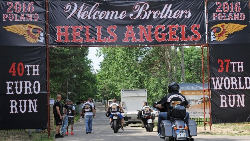 A group of Hells Angels bikers enters a enclosed holiday center near Warsaw, Poland, Friday, June 3, 2016. Hundreds of Hells Angels bikers from across Europe and the U.S. came to Poland for their annual meeting. (AP Photo/Alik Keplicz)