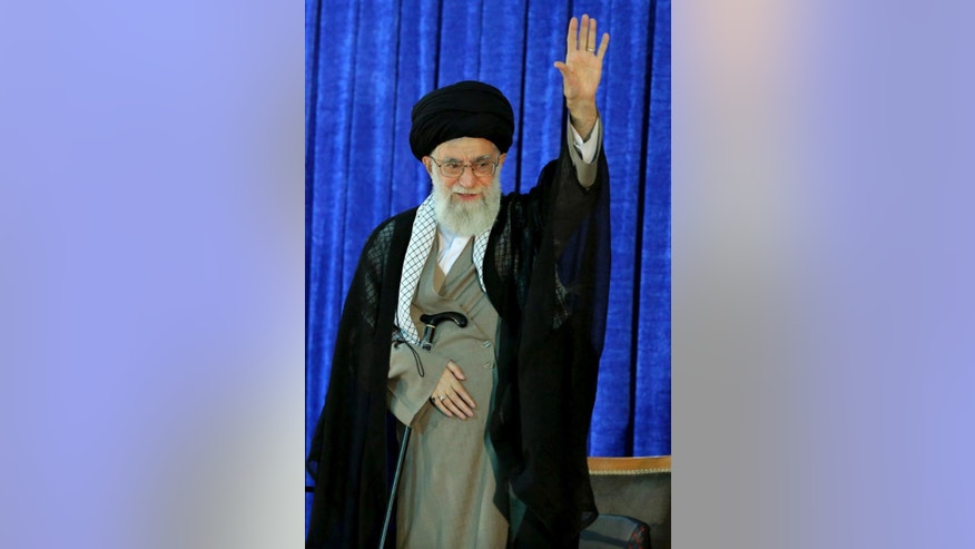 In this picture released by an official website of the office of the Iranian supreme leader, Supreme Leader Ayatollah Ali Khamenei waves to the crowd while attending a ceremony marking 27th death anniversary of founder of the Islamic Republic, Ayatollah Khomeini at his shrine just outside Tehran, Iran, Friday, June 3, 2016. Iran's top leader has ruled out cooperation with America against the Islamic State group, their common enemy in Syria and Iraq. (Office of the Iranian Supreme Leader via AP)