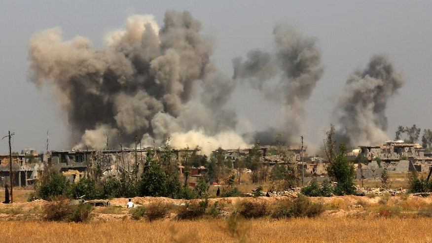 Smoke rises after an airstrike by U.S.-led coalition warplanes as Iraqi security forces advance towards Shuhada neighborhood of Fallujah to retake the city from Islamic State militants, Iraq, Friday, June 3, 2016. (AP Photo/ Khalid Mohammed)