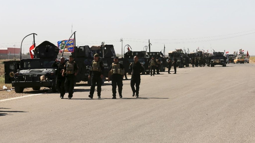 Iraqi military forces prepare for an offensive into Fallujah to retake the city from Islamic State militants in Iraq, Friday, June 3, 2016. The battle for Fallujah, now two weeks old, is shaping up unlike others in the Iraqi military's town-by-town war with the Islamic State group: Airstrikes have been sparingly employed, potentially violent Shiite militias have so far been kept to the perimeter, and the initial advance on the symbolically important town has been slow.(AP Photo/ Khalid Mohammed)