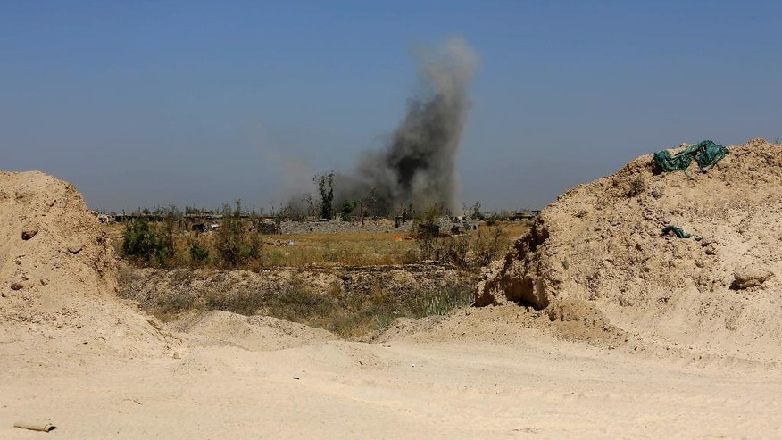 Smoke rises from Islamic State group positions after an airstrike by U.S.-led coalition warplanes as Iraqi counterterrorism forces face off with Islamic State militants in Nuaimiya neighborhood of Fallujah, Iraq, Friday, June 3, 2016. (AP Photo/ Khalid Mohammed)