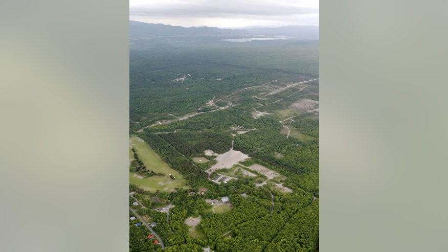 This aerial photo shows the building, center right, where the 7-year-old Japanese boy who went missing nearly a week ago, was found, in a military drill area in Shikabe, on the northernmost main island of Hokkaido Friday, June 3, 2016. The boy, missing since Saturday, was found unharmed Friday, police said, in a case that had set off a nationwide debate about parental disciplining. (Takaki Yajima/Kyodo News via AP) JAPAN OUT, MANDATORY CREDIT