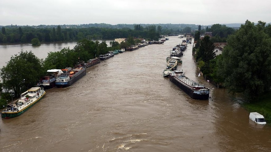 Boats are lined up on the flooded Loing Canal in St Mammes, where the Loing joins the Seine south of Paris, France, Thursday June 2, 2016. Floods inundating parts of France and Germany have left five people dead and thousands trapped in homes or cars, as rivers have broken their banks from Paris to Bavaria.(AP Photo/Jerome Delay)