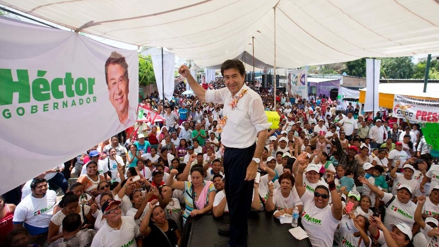 "In this May 18, 2016 photo, Hector Yunes Landa, candidate for Governor for the Institutional Revolutionary Party, PRI, and the coalition ""Para Mejorar Veracruz,"" or ""For Improving Veracruz,"" greets supporters during a campaign rally in Cosoleacaque, in the gulf coast state of Veracruz, Mexico. Mexican states elect new governors and the PRI, which runs the country in the middle of growing criticism and disenchantment for corruption cases, the violence and a bad economy, is trying to show that it has enough power to win the majority of the governorships. (AP Photo/Eduardo Verdugo)"