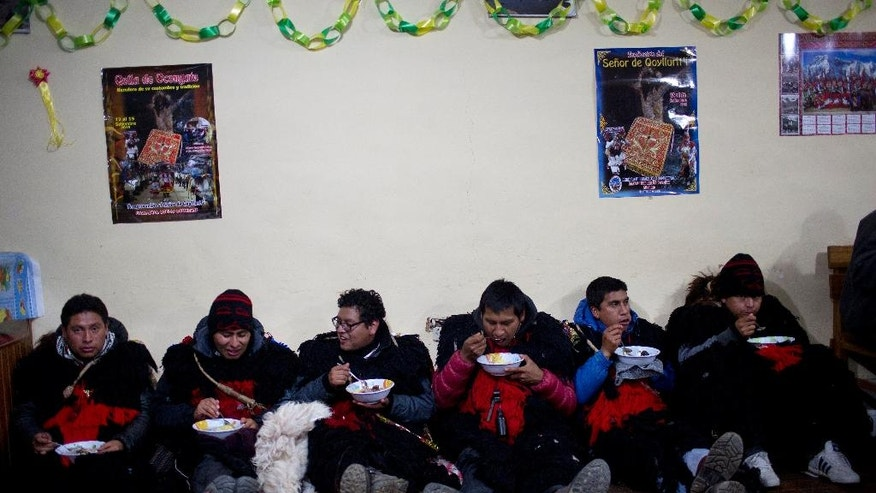 "In this May 23, 2016 photo, pilgrims dressed as ""Ukukus"", mythical half-man, half-bear creatures, eat soup gifted by parishioners at a parish in the city of Occongate, in Peru's Cusco region. The group of Ukukus, who are part of a ""nation"" that include musicians and dancers, met up in the town of Paucartambo, and traveled in the bed of a farm truck to the Sinakara Valley to take part in the syncretic festival Qoyllur Rit'i, translated from the Quechua language as Snow Star. (AP Photo/Rodrigo Abd)"