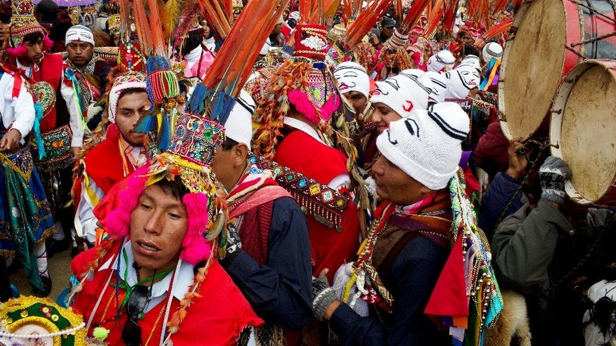 In this May 23, 2016 photo, pilgrims wait for the start of a procession to the Sanctuary of the Lord of the Qoyllur Rit'i, as part of the the syncretic festival of the same name, translated from the Quechua language as Snow Star, in the Sinakara Valley, in Peru's Cusco region. Tens of thousands of pilgrims crowd into the Andean valley, with dancers in multi-layered skirts and musicians with drums and flutes performing non-stop for the three-day festival. (AP Photo/Rodrigo Abd)