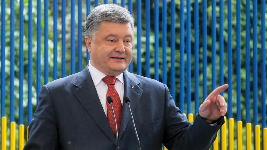 Ukrainian President Petro Poroshenko gestures while speaking to the media during his news conference in Kiev, Ukraine, Friday, June 3, 2016.  (AP Photo/Efrem Lukatsky)
