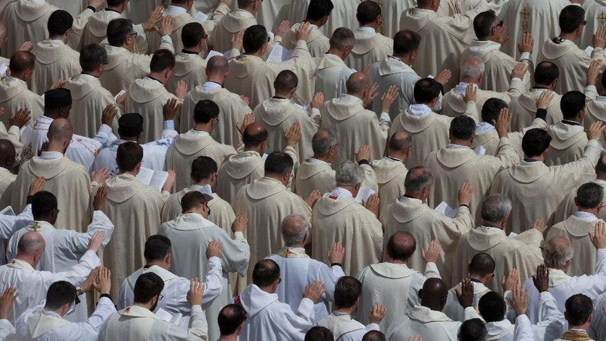 Priests pray as they attend a Jubilee mass celebrated by Pope Francis in St. Peter's Square at the Vatican, Friday, June 3, 2016. (AP Photo/Alessandra Tarantino)