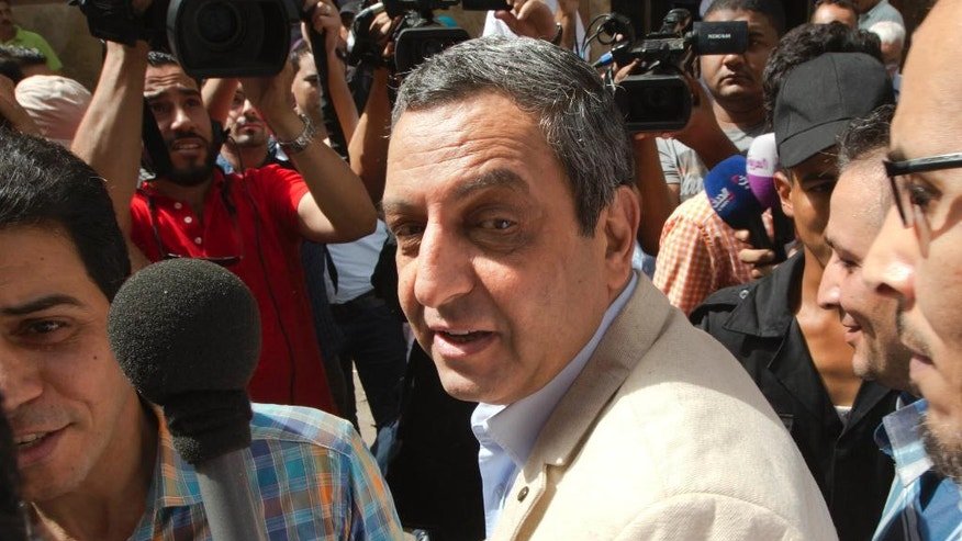 Yahia Kalash, the head of the journalists' union, is surrounded by cameramen as he arrives at Cairo south court in Cairo, Egypt, Saturday, June 4, 2016. The head of Egypt's journalists union and two of its board members are on trail over allegations that they harbored journalists wanted by authorities and spread false news. (AP Photo/Amr Nabil)