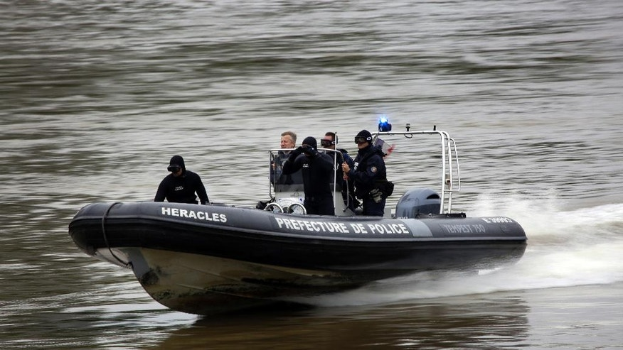 French police patrol the Seine river near the Eiffel tower in Paris, France Friday June 3, 2016.  Both the Louvre and Orsay museums were closed as the Seine, which officials said was at its highest level in nearly 35 years, was expected to peak sometime Friday.(AP Photo/Jerome Delay)
