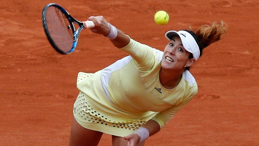Spain's Garbine Muguruza serves to Serena Williams of the U.S.  during their final match of the French Open tennis tournament at the Roland Garros stadium, Saturday, June 4, 2016 in Paris.  (AP Photo/Christophe Ena)