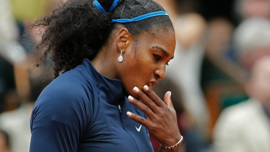 Serena Williams of the U.S. misses a return in the final of the French Open tennis tournament against Spain's Garbine Muguruza at the Roland Garros stadium in Paris, France, Saturday, June 4, 2016. (AP Photo/Alastair Grant)
