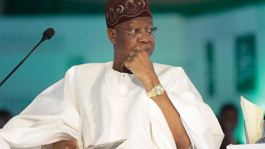 In this photo taken Monday April. 25, 2016, Nigeria Information Minister, Lai Mohammed, attends a town hall meeting in Lagos, Nigeria. Nigeria has seized more than $10.3 billion in looted cash and assets in the past year under President Muhammadu Buhari's anti-corruption campaign, the information minister announced Saturday June. 4, 2016. In addition, the government is expecting the repatriation of more than $330 million stolen from the public treasury and stashed in banks abroad. (AP Photo/Sunday Alamba)