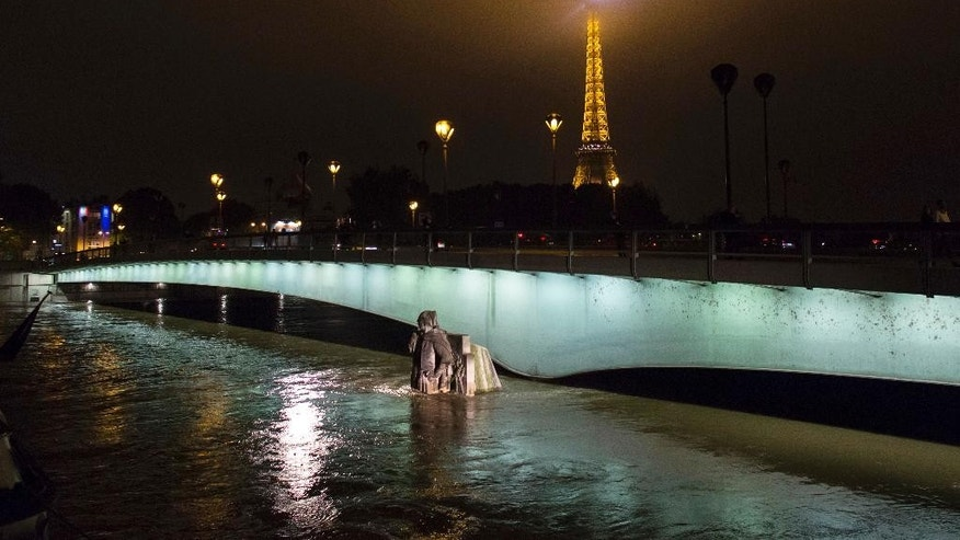The Zouave statue at the bridge Pont de l'Alma which serves as a measuring instrument for water levels during floods, is partly overflowing by the river Seine in Paris, Friday, June 3, 2016. The swollen Seine River kept rising Friday, spilling into Paris streets and forcing one landmark after another to shut down as it surged to its highest levels in nearly 35 years. Across the city, museums, parks and cemeteries shut down as the city braced for evacuations. (AP Photo/Kamil Zihnioglu)