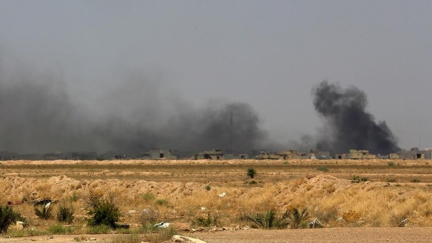 Smoke rises after an airstrike by U.S.-led coalition warplanes as Iraqi security forces advance towards Shuhada neighborhood of Fallujah, Iraq, Friday, June 3, 2016, during fighting between Iraqi security forces and the Islamic State group during a military operation to regain control the city.  The initial advance on the symbolically important town of Fallujah has been slow with Iraqi forces facing fierce resistance on the outskirts from well-entrenched militants.  (AP Photo/ Khalid Mohammed)