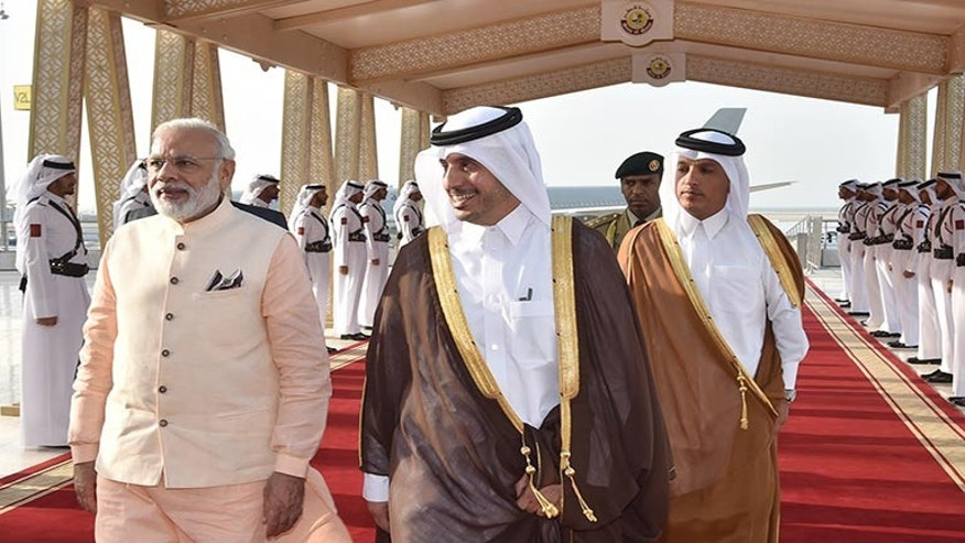 In this Saturday June 4, 2016 photo released by the Qatar Agency, QNA, Qatari Prime Minister and Minister of Interior Sheikh Abdullah bin Nasser bin Khalifa Al -Thani, front right, receives Indian Prime Minister Narendra Modi in Doha, Qatar. (Qatar News Agency via AP)