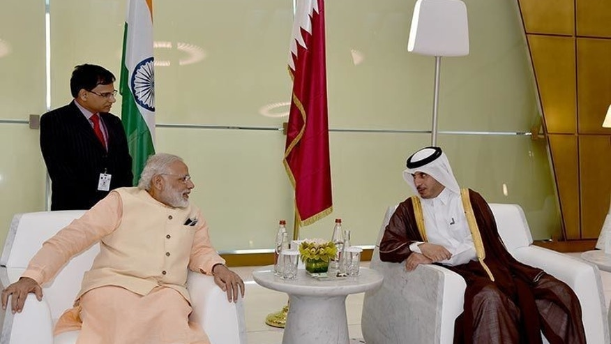 In this Saturday June 4, 2016 photo released by the Qatar Agency, QNA, Qatari Prime Minister and Minister of Interior Sheikh Abdullah bin Nasser bin Khalifa Al -Thani, right, receives Indian Prime Minister Narendra Modi, in Doha, Qatar. (Qatar News Agency via AP)