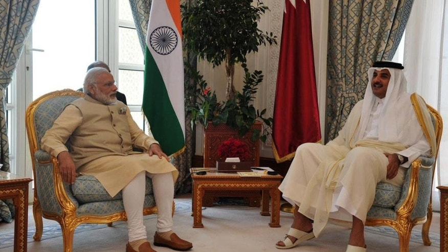 In this Sunday, June 5, 2016 photo released by the Indian Ministry of External Affairs's Twitter Page, Indian Prime Minister Narendra Modi, left, talks with Emir of Qatar Sheikh Tamim bin Hamad Al Thani, in Doha, Qatar. (Indian Ministry of External Affairs via AP)