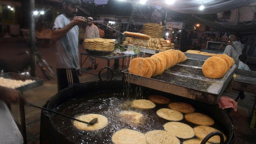 Pakistani vendors prepare traditional vermicelli for the upcoming Muslim month of Ramadan, in Karachi, Pakistan, Sunday, June 5, 2016. Muslims across the world will be observing the holy fasting month of Ramadan, when they refrain from eating, drinking and smoking from dawn to dusk. (AP Photo/Fareed Khan)