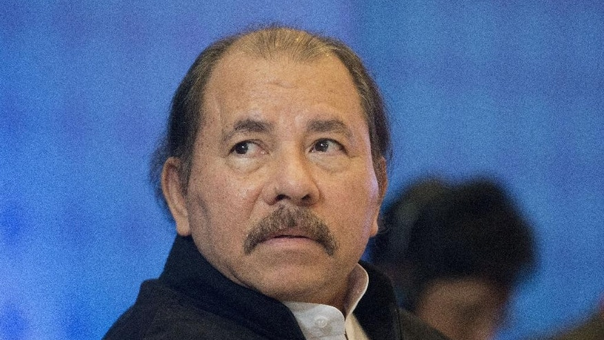 FILE - In this April 10, 2015, file photo, Nicaraguan President Daniel Ortega listens during a multi-lateral meeting with Central American Integration System Presidents, in Panama City, Panama.  Ortega's Sandinista party announced on Saturday, May 5, 2016, that he is officially running for reelection to what would be his third consecutive term as Nicaragua's president and the seventh straight time he has been the Sandinistas' candidate. (AP Photo/Pablo Martinez Monsivais, File)