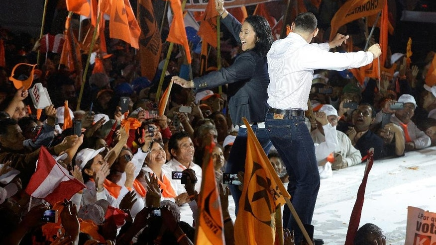 Presidential candidate Keiko Fujimori dances with her husband Mark Villanella during her closing presidential campaign rally in Villa el Salvador shantytown in Lima, Peru, Thursday, June 2, 2016. The South American country is gearing up for a tight June 5th runoff between the daughter of jailed former President Alberto Fujimori and former World Bank economist Pedro Kuczynski. (AP Photo/Martin Mejia)