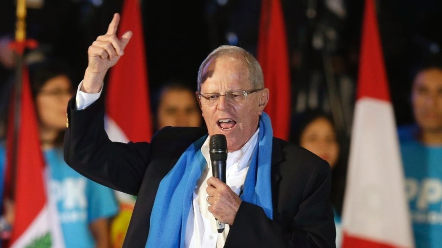 "Presidential candidate Pedro Pablo Kuczynski of the ""Peruanos por el Kambio"" political party gives a speech during his closing presidential campaign rally in Lima, Peru, Wednesday, June 1, 2016. The South American country is gearing up for a tight June 5th runoff between Keiko Fujimori, the daughter of jailed former President Alberto Fujimori, and former World Bank economist Pedro Kuczynski. (AP Photo/Martin Mejia)"