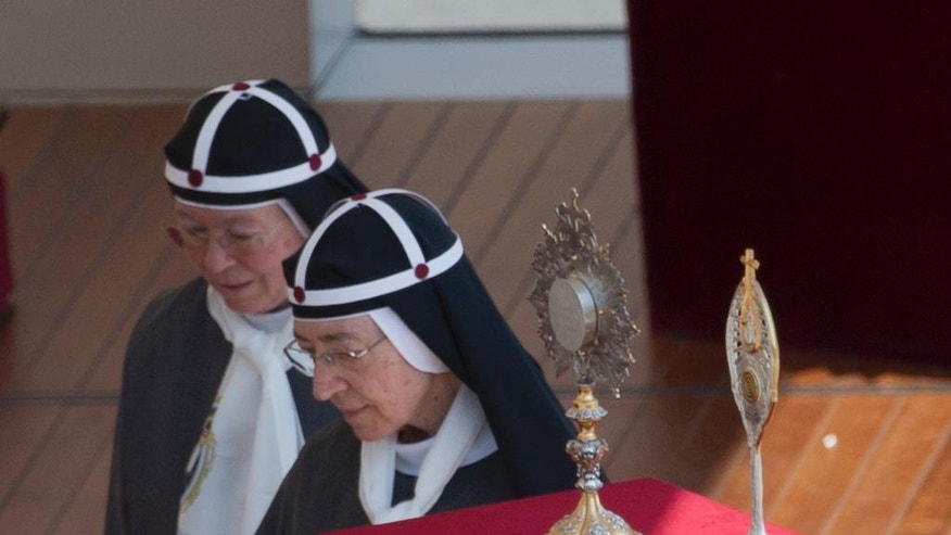 The relics of Elizabeth Hesselblad and of Stanislaus of Jesus and Mary Papczynsk are placed in front of the altar in St. Peter's Square at the Vatican during the canonization ceremony led by Pope Francis, Sunday, June 5, 2016. Pope Francis has canonized Elizabeth Hesselblad, a Lutheran convert who hid Jews during World War II and Stanislaus, the founder of the first men's religious order dedicated to the immaculate conception. (AP Photo/Alessandra Tarantino)