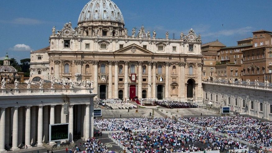 Faithful fill St. Peter's Square at the Vatican during a canonization ceremony led by Pope Francis, Sunday, June 5, 2016. Pope Francis has canonized Elizabeth Hesselblad, a Lutheran convert who hid Jews during World War II and Stanislaus of Jesus and Mary Papczynski, the founder of the first men's religious order dedicated to the immaculate conception. (AP Photo/Alessandra Tarantino)