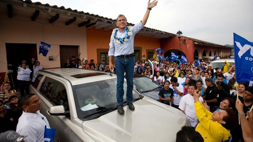 "In this May 17, 2016 photo, Miguel Angel Yunes Linares, candidate for Governor for the National Action Party, PAN, and the coalition ""Unidos para rescatar Veracruz,"" or ""United to rescue Veracruz,"" greets supporters during a campaign rally in Ixhuacan, in the gulf coast state of Veracruz, Mexico. Veracruz is the biggest of the states choosing governors and one of five, along with Durango, Hidalgo, Quintana Roo and Tamaulipas, in which the governing  Institutional Revolutionary Party has never lost even as its once iron grip on power has eroded across the nation as a whole. (AP Photo/Eduardo Verdugo)"