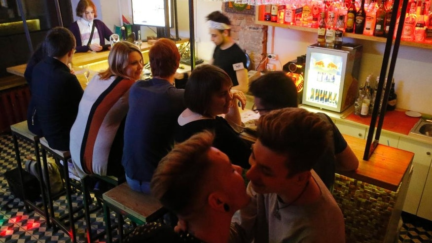 In this Friday, May 27, 2016 photo, visitors relax in a gay nightclub in St. Petersburg, Russia. Russian crime gangs find gays easy targets for blackmail. In the past two years, an increasing number of gays has fallen victim to criminal gangs operating through gay dating sites, rights groups say. (AP Photo/Dmitri Lovetsky)