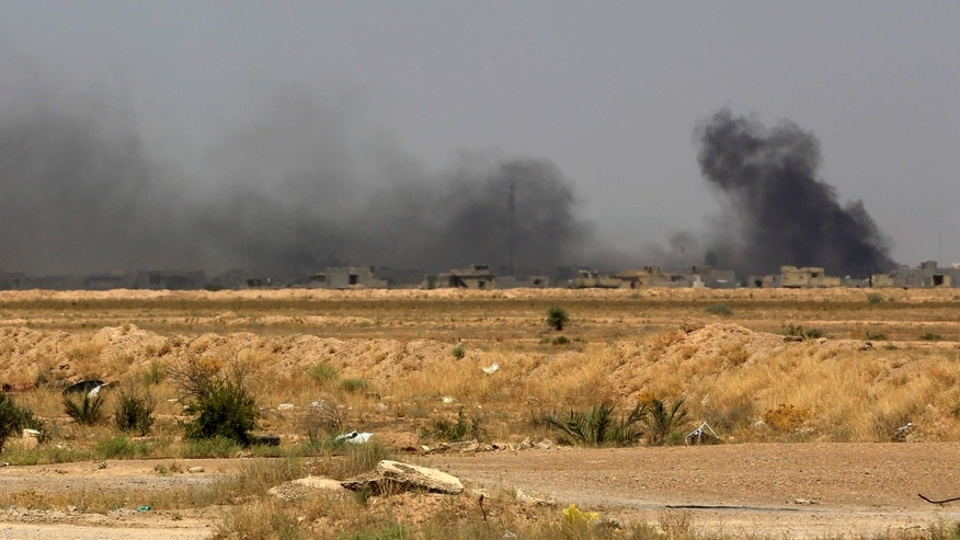 Smoke rises after an airstrike by U.S.-led coalition warplanes as Iraqi security forces advance towards Shuhada neighborhood of Fallujah, Iraq, Friday, June 3, 2016, during fighting between Iraqi security forces and the Islamic State group during a military operation to regain control the city.