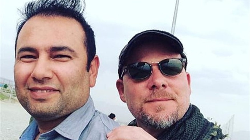 David Gilkey, a veteran news photographer and video editor for National Public Radio, and an Afghan translator, Zabihullah Tamanna, were killed while on assignment in southern Afghanistan on Sunday, a network spokeswoman said.