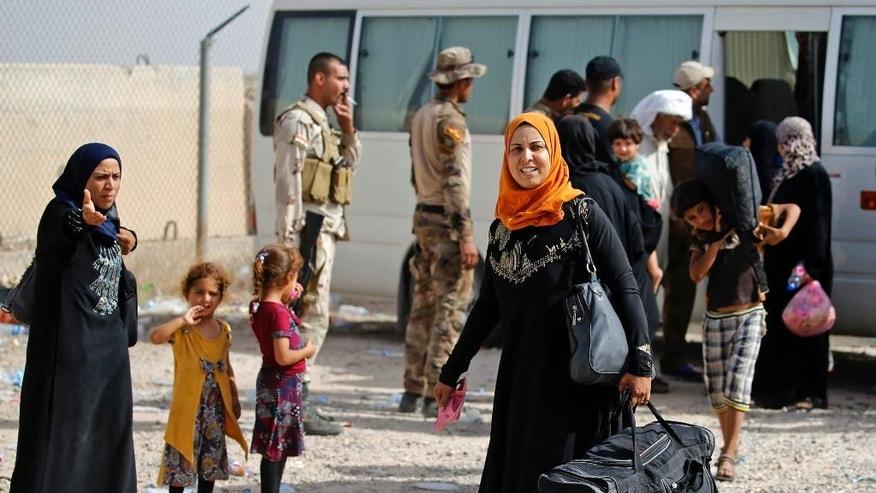 June 4, 2016: Displaced Iraqi families arrive to an Iraqi army camp after fleeing their homes during fighting between Iraqi security forces and the Islamic State group, outside Fallujah, Iraq. The Iraqi army is attempting to retake the western city.