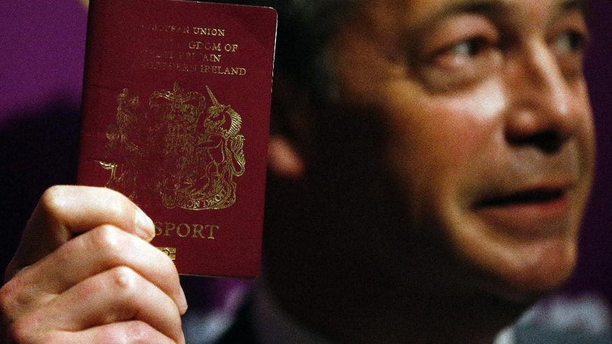 UK Independence Party (UKIP) party leader Nigel Farage shows his passport as he addresses media and party members during a speech focusing on the upcoming EU referendum in London, Friday, June 3, 2016. Farage is a leading campaigner advocating Britain to cut its ties with the rest of Europe, known by the name, 'Brexit'.(AP Photo/Frank Augstein)