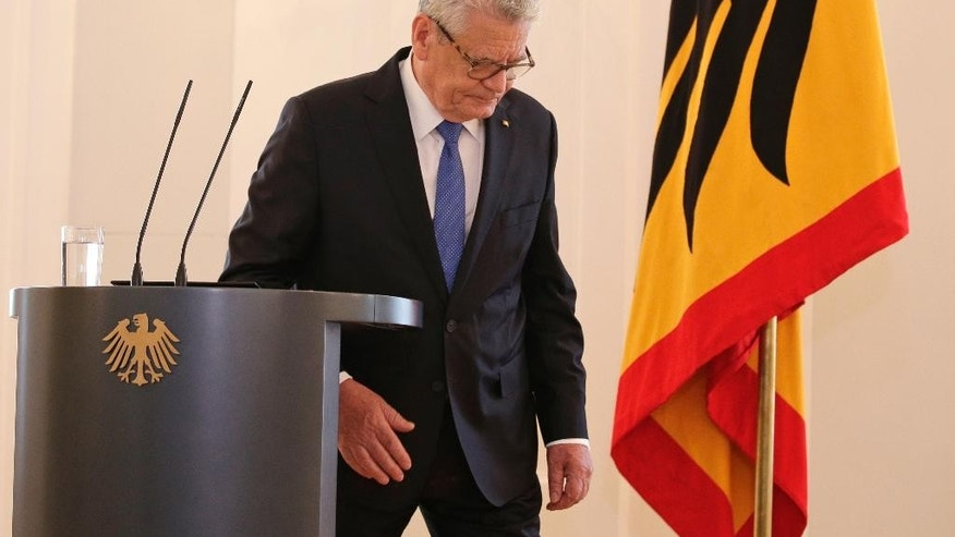 German President Joachim Gauck leaves after a statement where he announced that we will not run for a second term in Berlin Monday, June 6, 2016. (AP Photo/Michael Sohn)