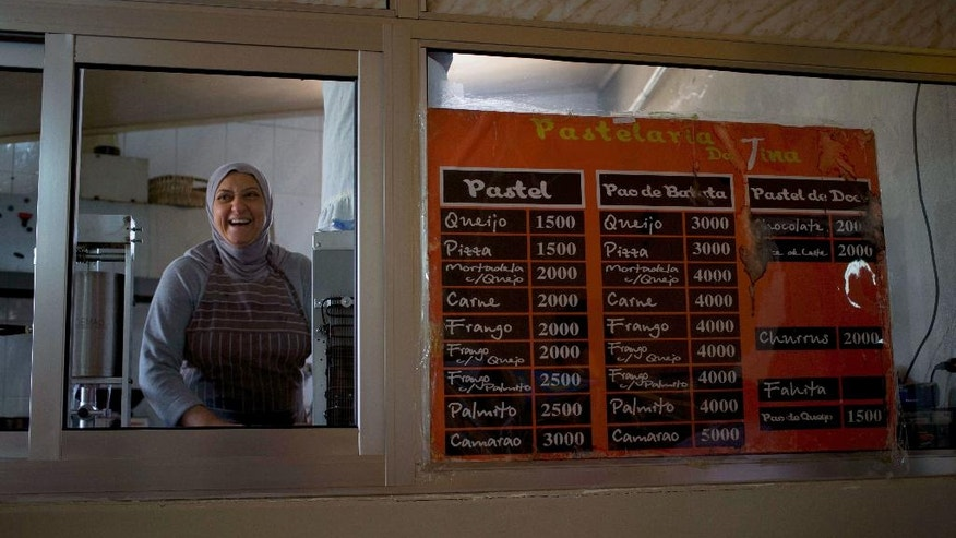 In this Friday, May 27, 2016 photo, Yazdeh Hindi a Brazilian-Lebanese cook works at her sister's Portuguese bakery or pastelaria in the village of Sultan Yaacoub, 9 kilometers (5 miles) from the Syrian border, east Lebanon. At the eastern edge of the rural Bekaa Valley, where the rocky hillsides are stippled with cherry trees, a generations-old kinship with Brazil has imbued two Lebanese villages with a Latino spirit. Lusi and Sultan Yaacoub are home to more than one thousand Brazilian nationals, many of whom speak Portuguese as fluently as they do Arabic. (AP Photo/Hassan Ammar)